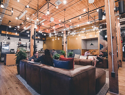 What are the benefits of working at a WeWork communal office space